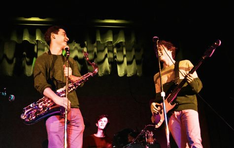 Seniors Stephen Tabhaz and Lance Brady, and junior Jack Dennison jam out during their  Battle of the Bands performance.