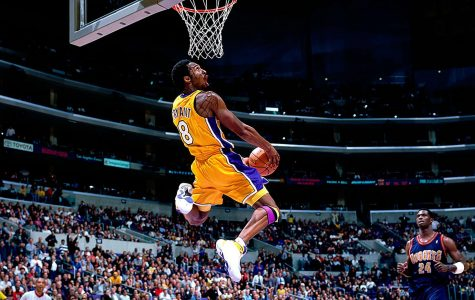 The late Kobe Bryant soars through the air for a slam dunk.