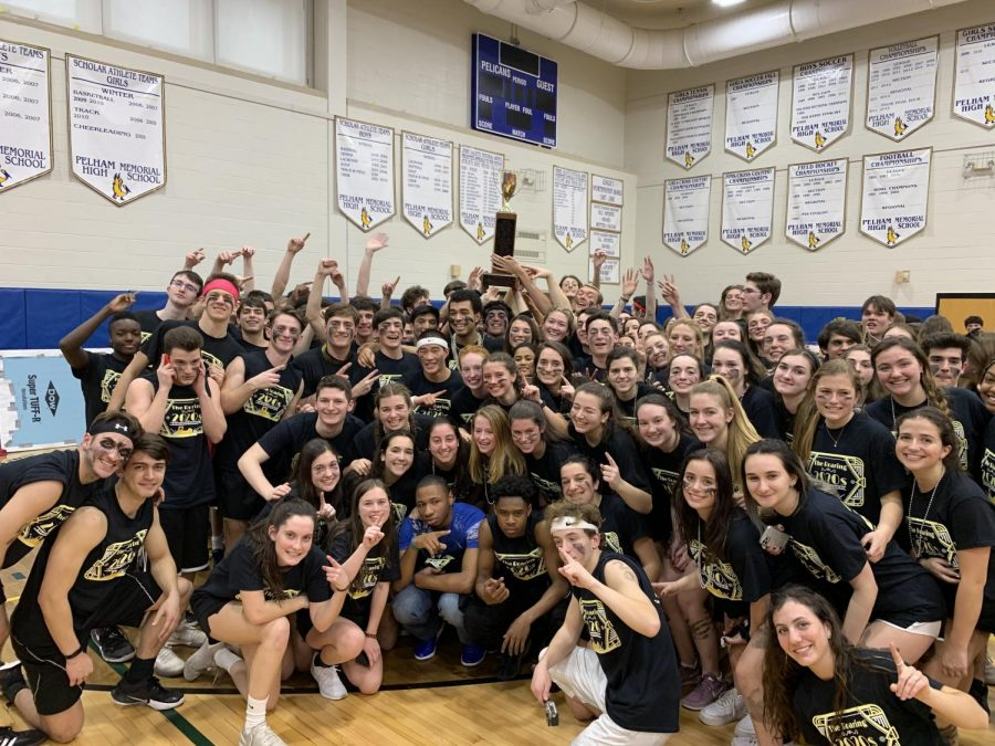 The+seniors+hold+aloft+the+Charlie+Wilson+Trophy%2C+awarded+to+the+winning+Olympic+grade.+The+trophy+is+named+for+Charlie+Wilson%2C+former+Pelham+District+Superintendent%2C+who+initiated+the+Olympic+games+here+at+Pelham.