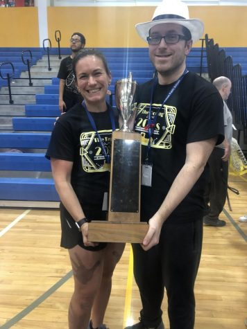 Mrs. Waters and Mr.Sirico holding the 2020 olympics trophy