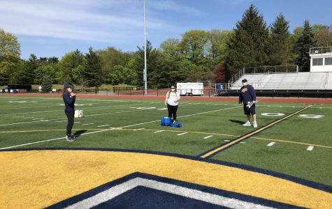 PGVL coaches Kayleigh Howe and Monica Mullen and Athletic Director Steve Luciana on Glover Field setting up to honor PGVL seniors on May 14, 2020.