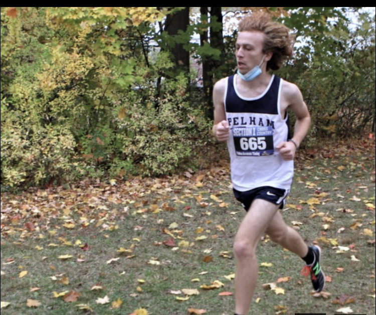 Junior Ben Levine races through the cross country course.