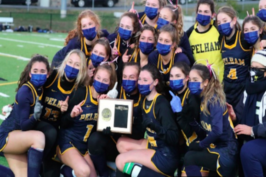 The+victorious+Field+Hockey+Team+receives+their+plaque+after+a+9-1+win+against+top-ranked+small+school+Rye+Neck.