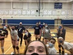 The girls varsity Volleyball team get ready to start play at an open gym session.